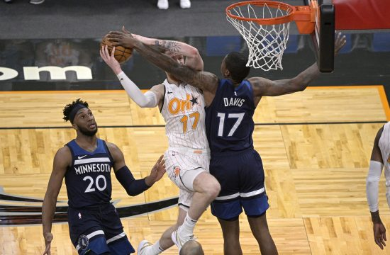 Orlando Magic forward Ignas Brazdeikis (17) is fouled by Minnesota Timberwolves center Ed Davis (17), right, while going up for a shot as Timberwolves forward Josh Okogie (20) watches during the second half of an NBA basketball game, Sunday, May 9, 2021, in Orlando, Fla. (AP Photo/Phelan M. Ebenhack)